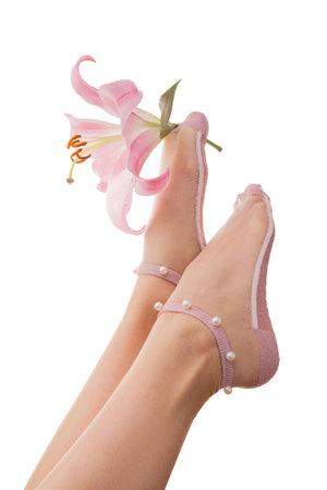 Female legs in socks with flowers. Lilies in women's feet.