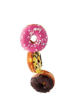 Stop motion donuts on a white background. Glazed donuts stack. Standard-Bild