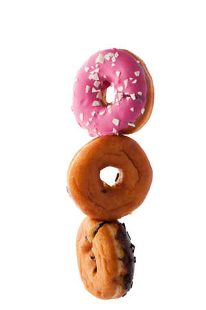 Stack of donuts hanging in the air isolated on white background.