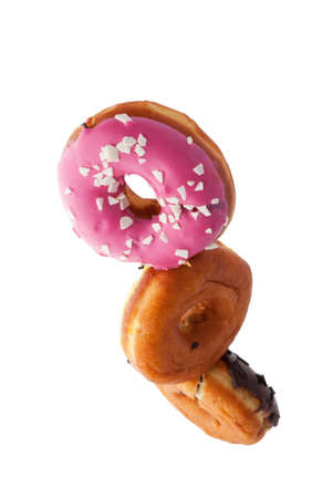 Delicious donuts fly and levitate in space. White background. Standard-Bild