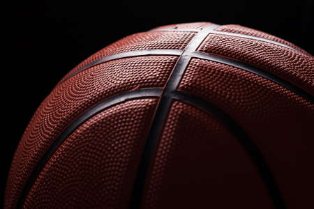 Basketball ball close-up black background. Banque d'images