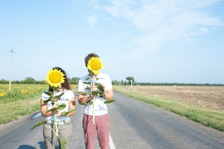 The couple in love in a field of sunflowers Stock Photo