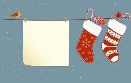 stocking: Christmas socks full of candies hanged on a clothesline next to a piece of paper