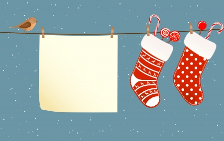 stockings: Christmas socks full of candies hanged on a clothesline next to a piece of paper