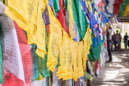 Colorful Buddhist prayer flags handing on a bridge in Bhutan photo