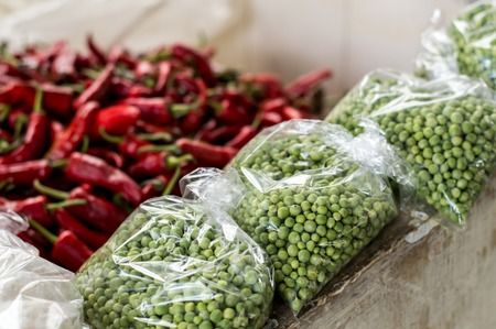 red chilly: Peas in sacks in front of red chilly peppers in Bhutan