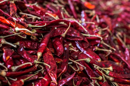Detail of a red hot chilly peppers on a pile Stock Photo