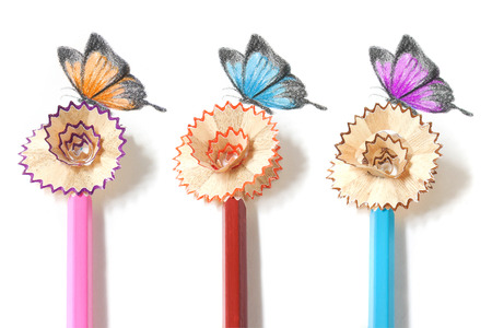 sharpening: Colored pencil sharpening and butterfly drawing Stock Photo