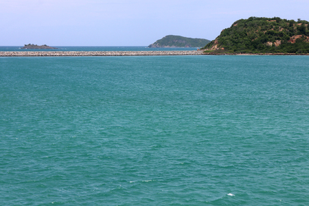 Thailand deep blue sea horizon seascape view at sunshine noon, wide nature scenery travel with white clouds sky. Green ocean wave ripple on windy summer season and small tree rock island landscape.