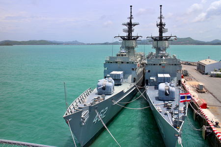 Chonburi, Thailand. 14 August 2016 - Large combat warship in deep blue sea beside HTMS Chakri Naruebet (CVH-911) of Royal Thai Naval Institute, Aircraft Carriers at port of Sattahip Navy base. Editorial
