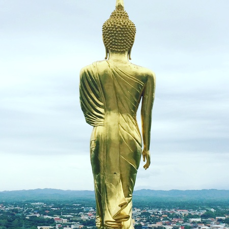 back: Gold Buddha in high view sky background