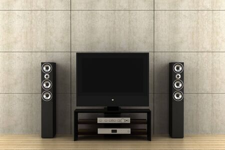 modern tv with speakers in front of gray wall Stock Photo
