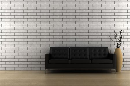 black sofa and vase with dry wood in front of brick wall photo