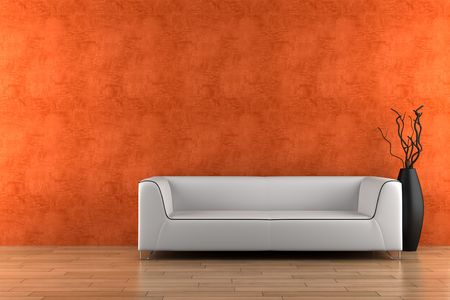 white sofa and vase with dry wood in front of orange wall photo