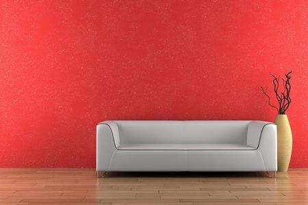 white sofa and vase with dry wood in front of red wall photo