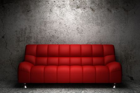 divano: divano in pelle rossa davanti al muro di cemento grunge  Archivio Fotografico