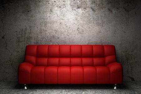 leren bank: rood lederen sofa voor grunge concrete muur Stockfoto