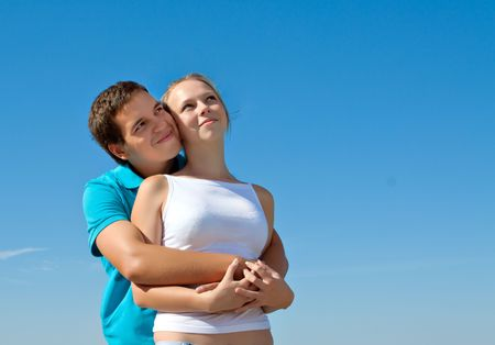 young couple embracing and looking in the sky Stock Photo - 7693855