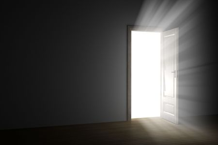 opening door: bright light through an open door in empty room Stock Photo