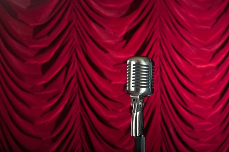 vintage microphone in front of red curtain