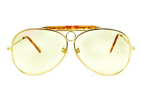 yellow sunglasses isolated on white background photo