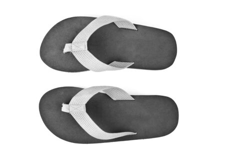 flip: pair of black flip flops isolated on white background