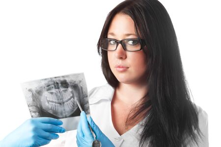 brunette young female dentist holding x-ray isolated on white background photo