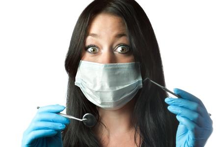 female dentist in mask with amazed eyes isolated on white photo