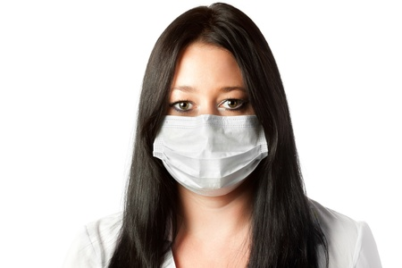 attractive female brunette nurse in mask isolated on white background photo