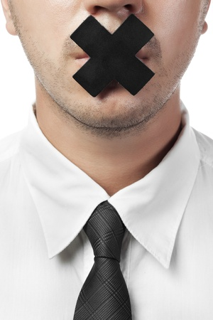 quiet adult: uomo in camicia e cravatta con bocca chiusa isolata on white Archivio Fotografico
