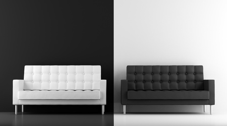 modern sofa: black and white couches in front of wall Stock Photo
