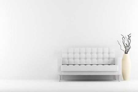 leather couch and vase with dry wood in front of white wall