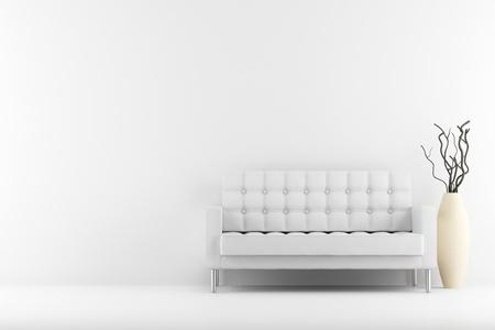 sofá de cuero y un florero con madera seca en frente de la pared blanca Foto de archivo