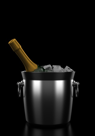 champagne bottle in bucket with ice isolated on black background photo