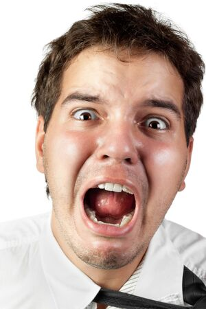 frustrated student: young office worker mad by stress screaming isolated on white
