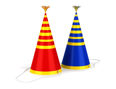 birthday hat: two colored stripped birthday caps isolated on white background