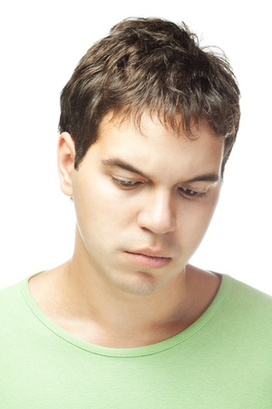 portrait of sad young man isolated on white background Stock Photo