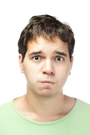 pathetic: portrait of pitiful young man isolated on white background
