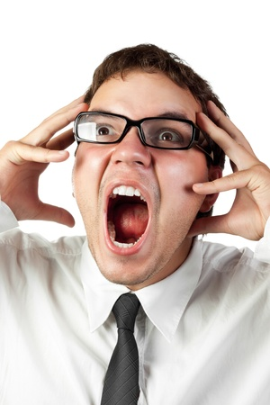 crazy man: young office worker in glasses mad by stress screaming isolated on white