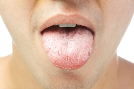 closeup of young men shows tongue isolated on white background Stock Photo