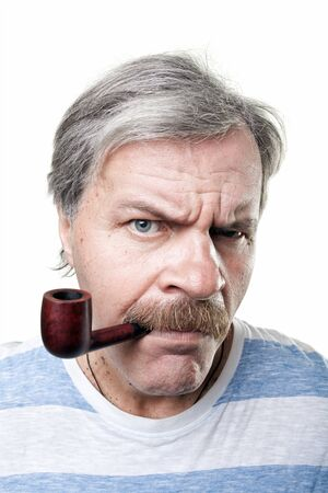 gloomy mature man with smocking pipe isolated on white background photo