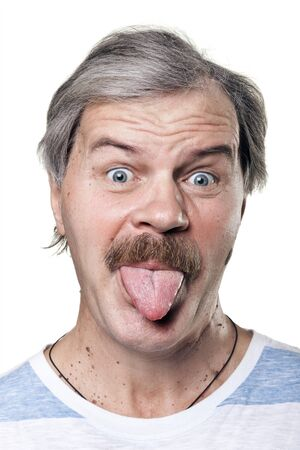 funny mature man shows tongue isolated on white background photo