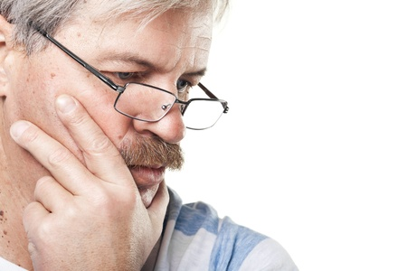 portrait of thoughtful mature caucasian man isolated on white background Stock Photo - 12376288