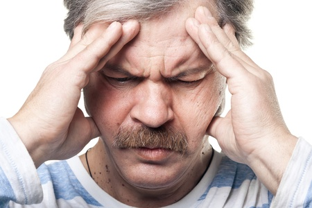 migraine: mature man having very strong pain isolated on white Stock Photo
