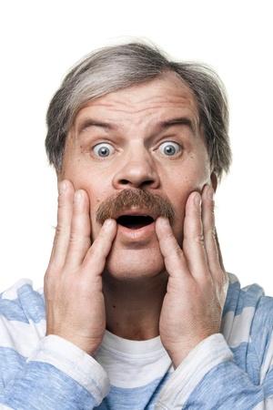 amazed mature man portrait isolated on white background Reklamní fotografie