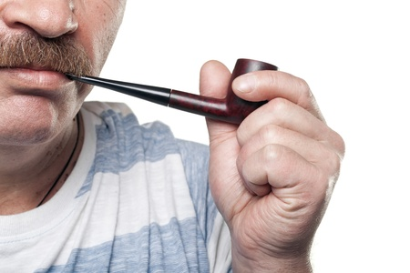 mature caucasian man holding smoking pipe in hand isolated on white background photo