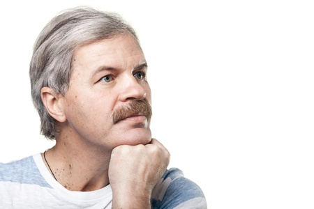 portrait of thoughtful mature caucasian man isolated on white background photo