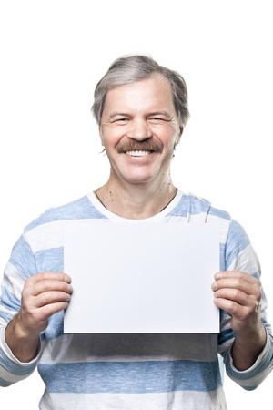 mature man holding a blank billboard isolated on white background photo