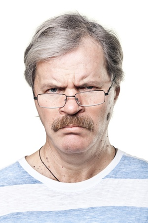 sullen caucasian mature man in glasses isolated on white background photo