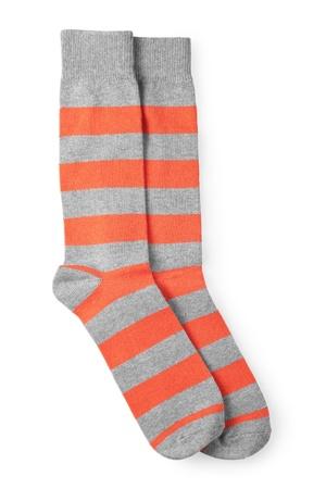 white socks: two striped orange and gray socks isolated on white background Stock Photo
